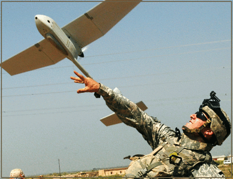 soldier army military launching a Raven UAV