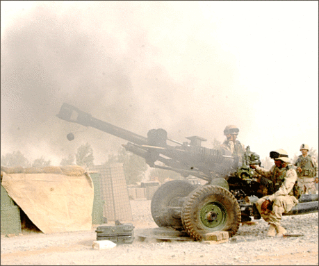 military army vehicle firing M119 howitzer