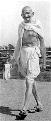Mohandas Gandhi walking