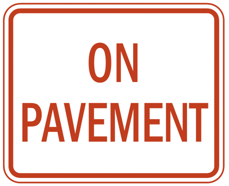 US street sign on pavement