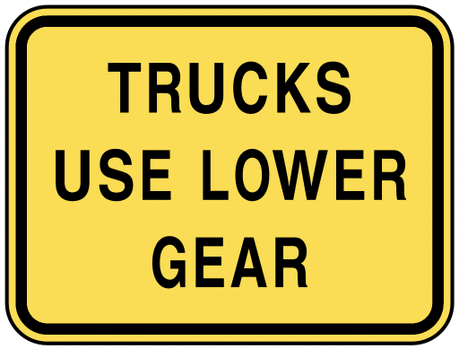 warning street sign trucks use lower gear
