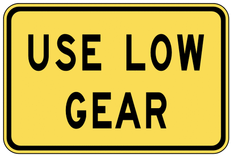 warning street sign use low gear